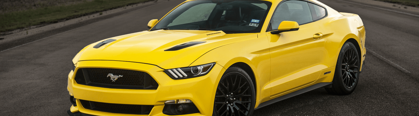 Bright yellow wrap on a Mustang